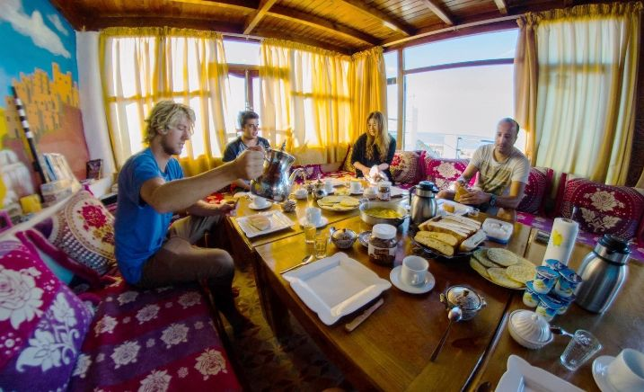 surfers eating Moroccan breakfast on holiday