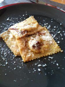 stuffed ravioli and cheese on a plate