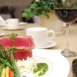 rare steak with vegetables and glass of red wine