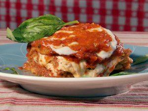Italian dish of parmigiana di melanzane with basil