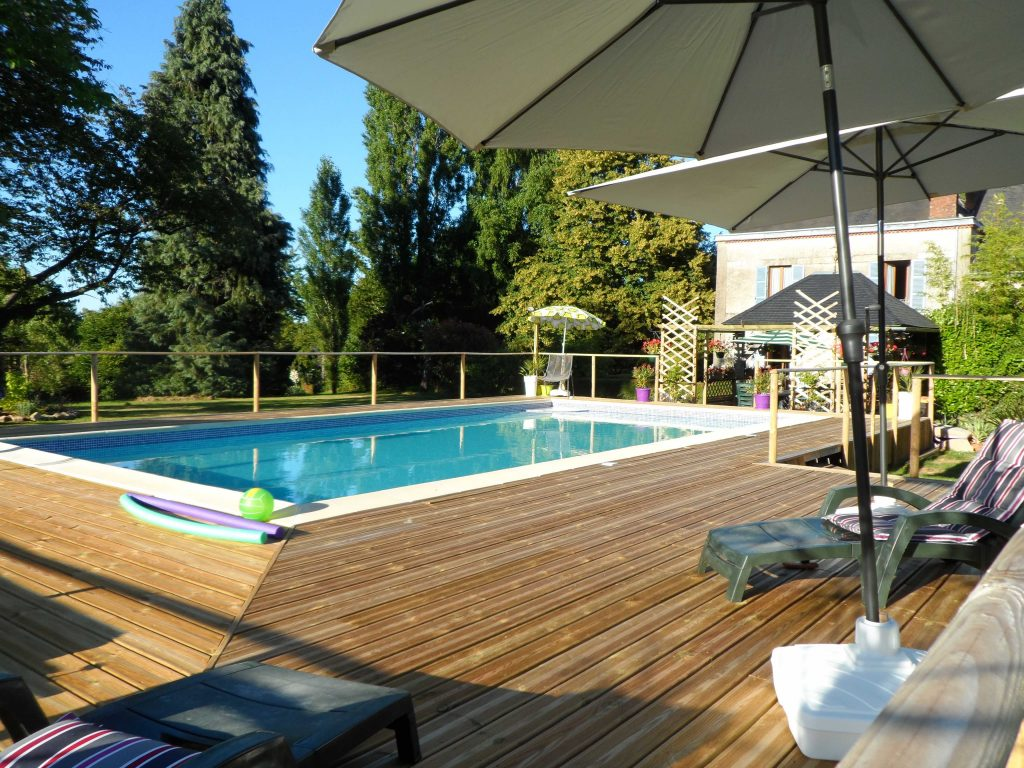 swimming pool and decking area outside French home