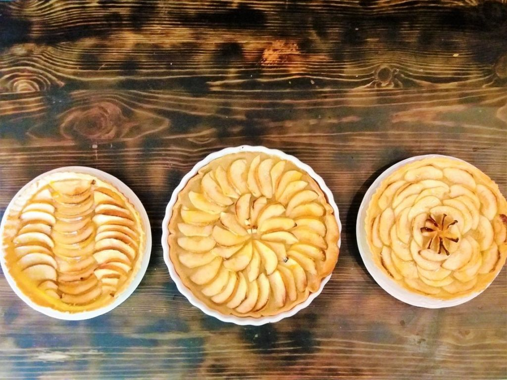 french apple tarts on wooden table