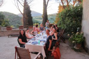 group dinner outside on yoga retreat in italy