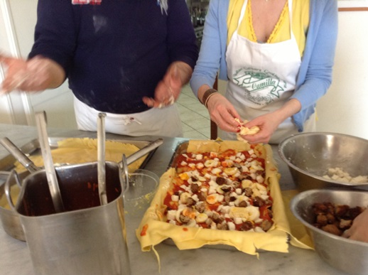 Pizza making in Sorrento - Chef Biaggio explaining how to put together a lasagne