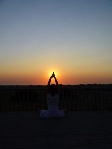 sunset yoga on holiday in Spain