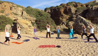 yoga lesson on the beach in Spain