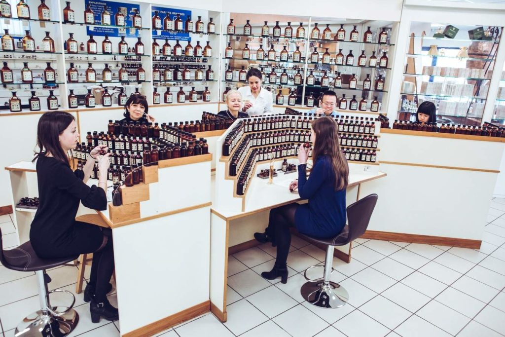 group try different scents in Grasse perfume studio