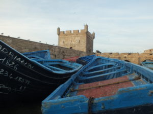 blue fishing boats in port of Essaouira in Morocco