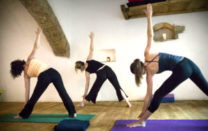 Yoga_retreat_with_cycling_Rome_yoga_side_stretching