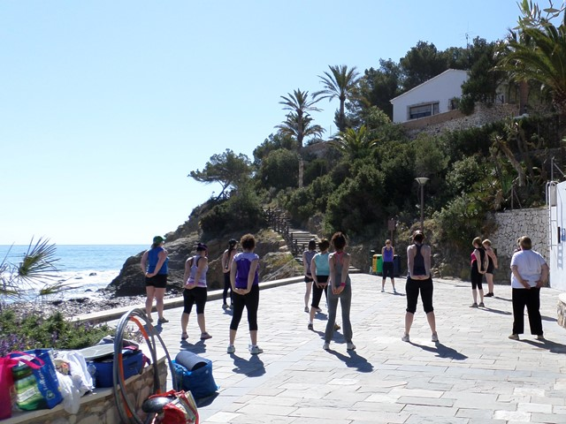 group fitness session by the sea in Spain