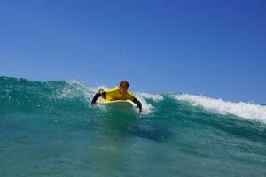 Surfing_holiday_fuerteventura_lying_surfing