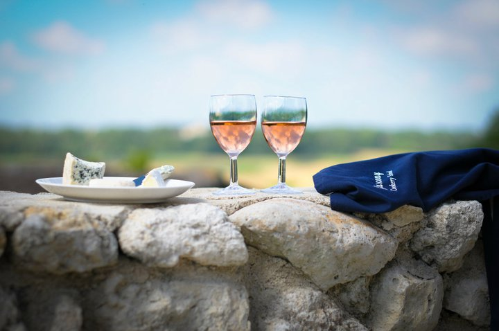 food and wine on stone fence during holiday in Gascony