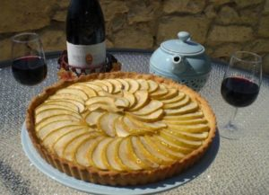 tarte aux pommes with glass of wine