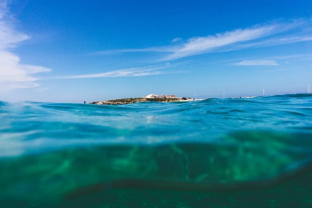 half shot of underwater and Peniche beach view