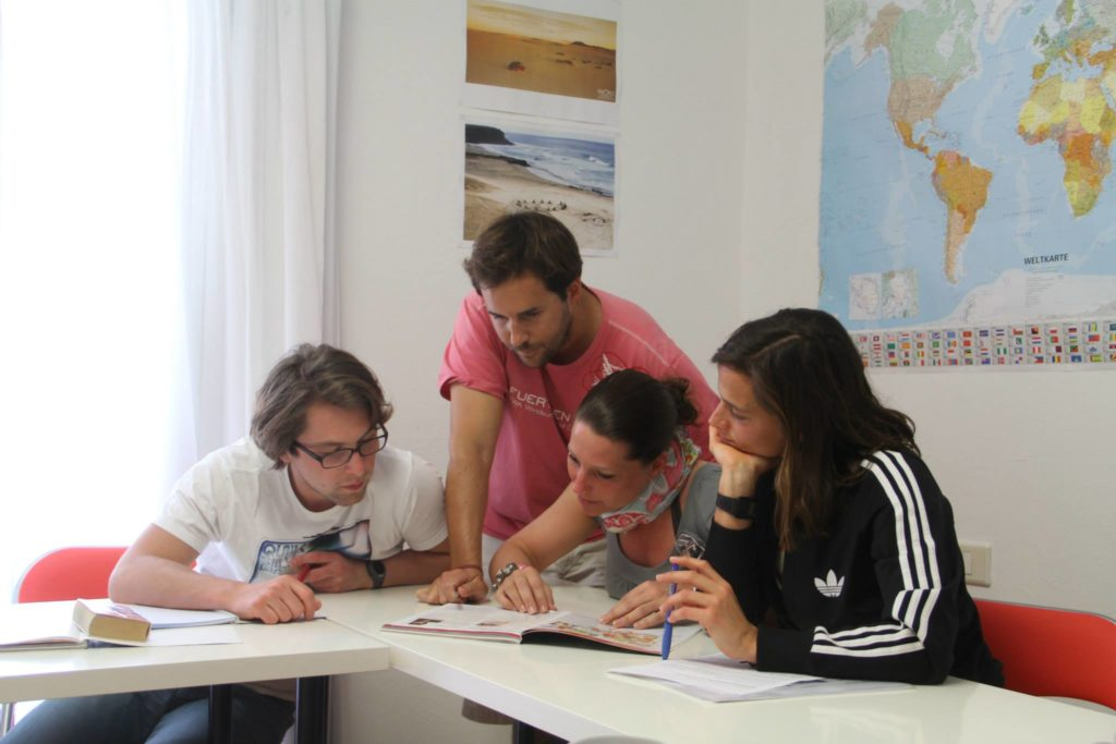 Jorge teaching Spanish language to students on holiday in Fuerteventura