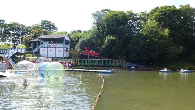 Zorbing by lake resort on holiday