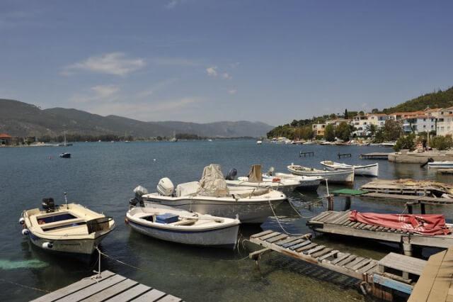 Boats docked in harbour in Poros, Greece
