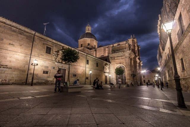 square in Salamanca at night with church