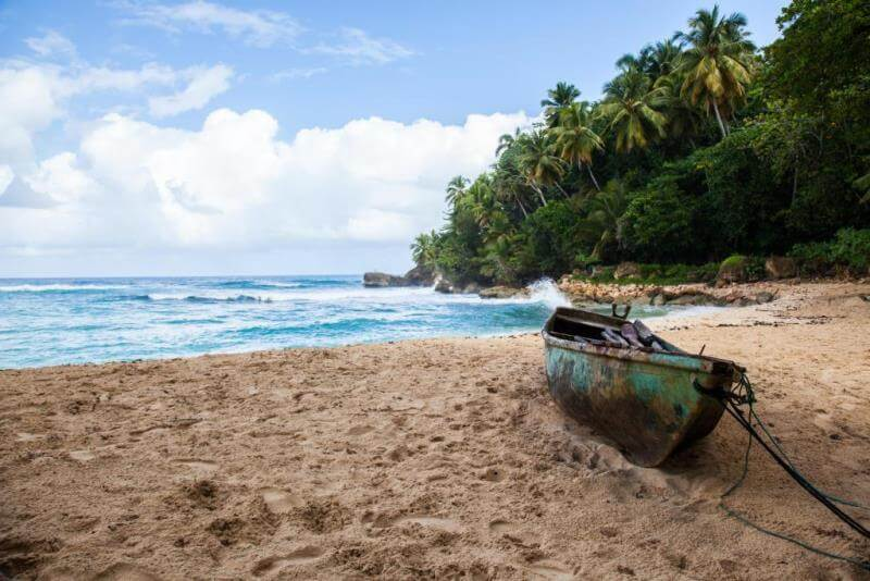 old row boat on beach in Dominican Republic