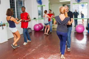 language holiday students dancing salsa in dance studio