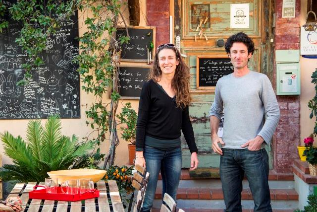 Hosts Benoit and Corinne in front of b&b