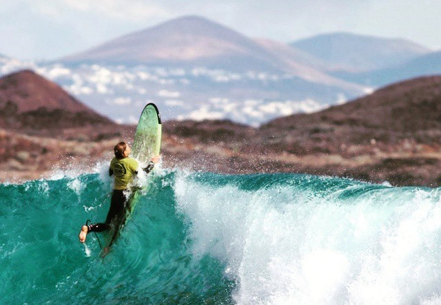 female surfer riding the waves in Fuerteventura