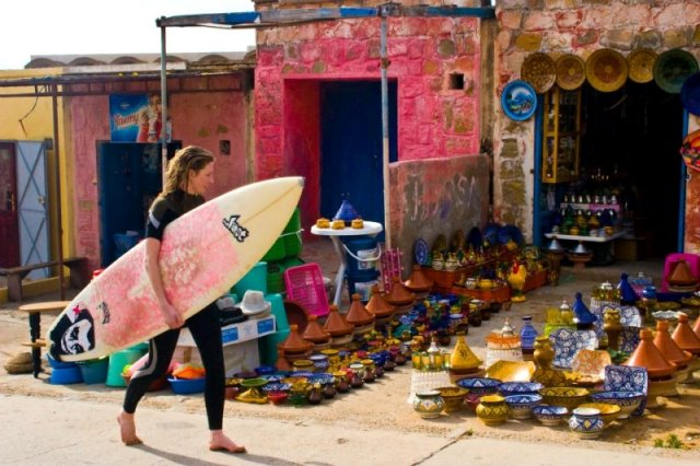 surfing girl walking through Taghazout