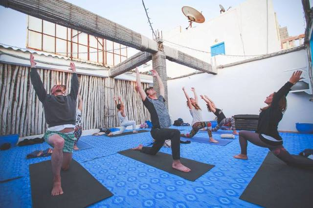 group doing yoga in Morocco