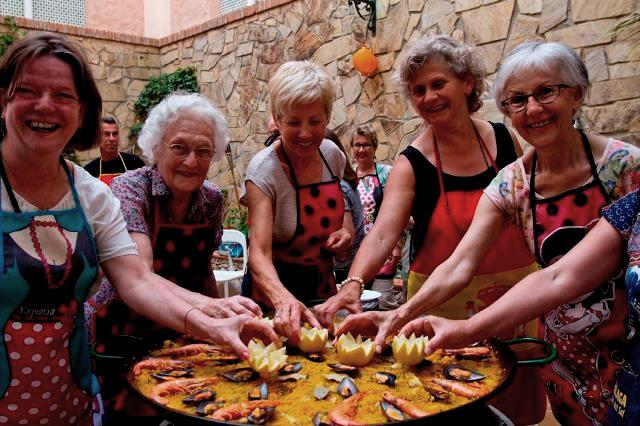 Cooking class during spanish holiday in Nerja Spain - women in aprons