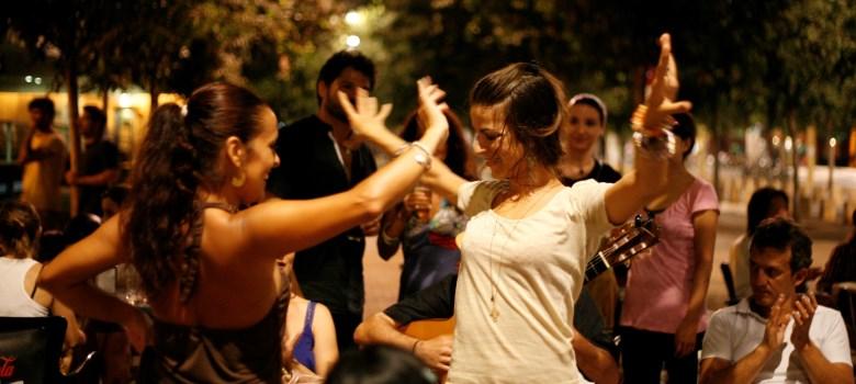 dancers dancing flamenco outside at night in public