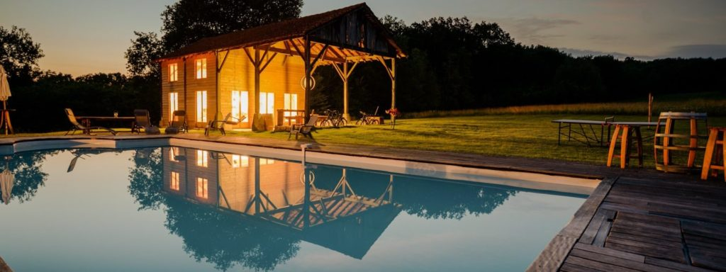 Restored barn and pool lit up in France