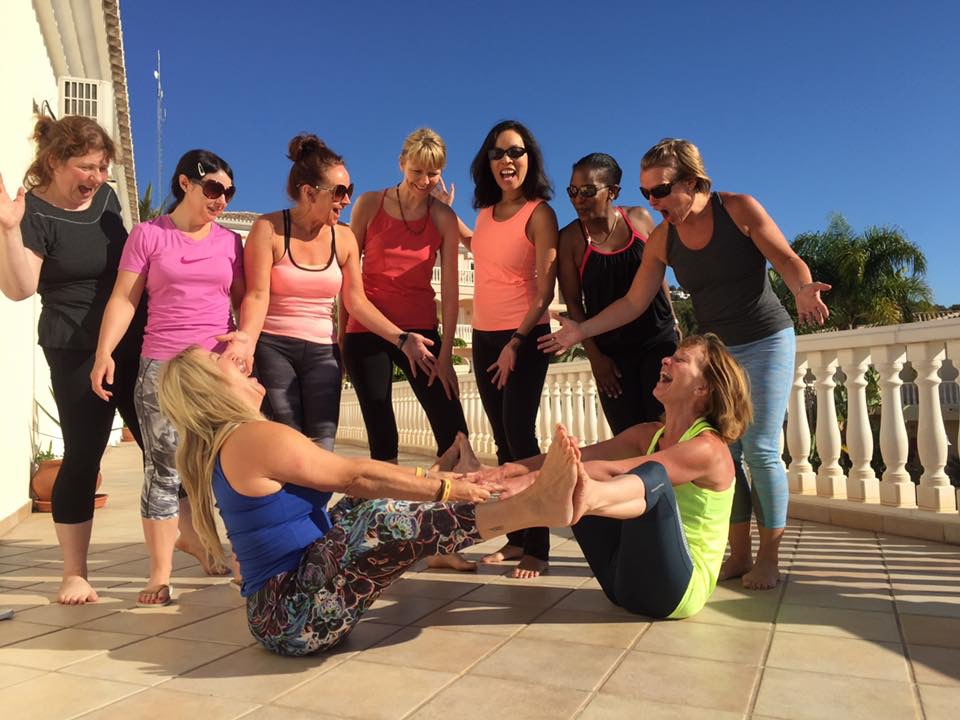 women train together as other watch and laugh