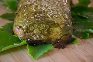 finished cheese pie wrapped in grape leaves