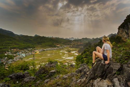 female travellers looks over valley in Vietnam