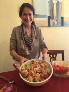 chef with bowl of panzanella salad