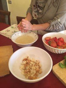 chef soaking bread for panzanella recipe