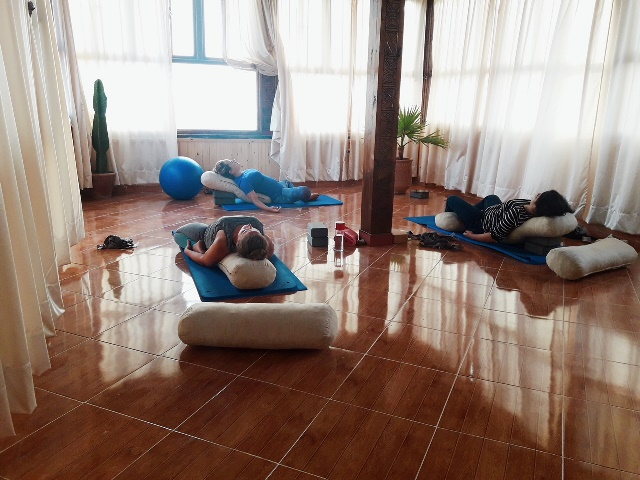 yoga guests lying down in a yoga class