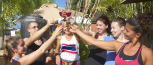 retreat guests raise a glass of juice together