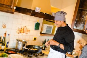 Chef Fabrizio cooking in his kitchen in Tuscany