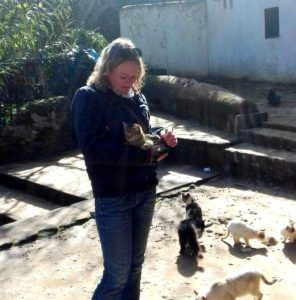 Woman holding cat in arms in Morocco