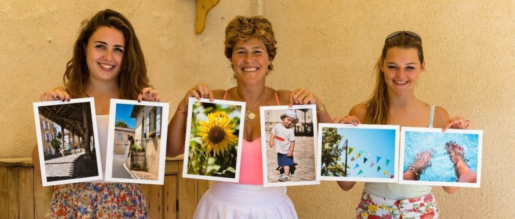 Photography guests holding up A4 prints of their images