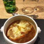 bowl of French onion soup with cheesy croutons