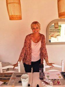 Tutor Julie standing behind table of card making