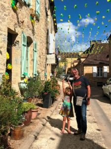 Host Tom and daughter in a French street