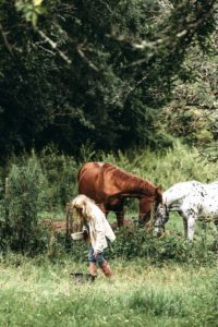 Art tutor Jo in the field with her two horses