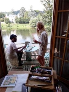 Jo helping her painting guest paint a lake in France