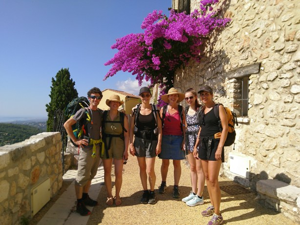 Hikers in French mountain village in the summer
