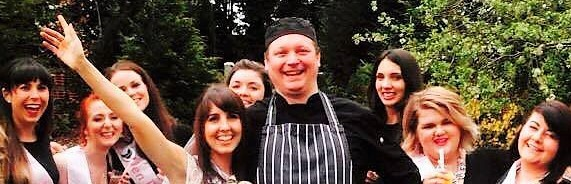 Chef with a group of female guests in Normandy