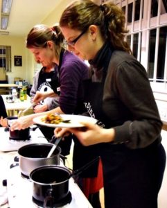 Guests cooking in the kitchen in the gite