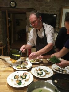 Chef Poul plates up oysters in his kitchen